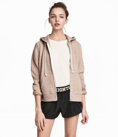 Beige melange. Sweatshirt jacket with a lined drawstring hood, zip at front, side pockets, and ribbing at cuffs and hem. Soft, brushed inside.