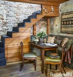 """Banquette dining area - Cameron Schwabenton Restored a """"Kitchen House"""" With a Modern Twist Interior Decorating Styles, Interior Design, Southern Cottage, Balustrades, Charleston Homes, Dining Nook, Banquette Dining, Dining Table, Under Stairs"""
