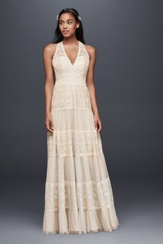 Light, airy, and perfect for a beach ceremony, this plunging halter A-line dress features alternating bands of delicate lacework and dotted point d'esprit tulle.   By DB Studio  Polyester  Back zipper; fully lined  Dry clean  Imported