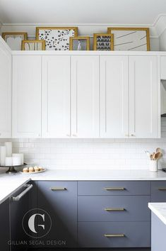 White and gray kitchen design boasting brass hardware- small round brass knobs o. White and gray kitchen design boasting brass hardware- small round brass knobs on white shaker upper cabinets and long brass pulls on flat front lower gray cabinets. Kitchen Cabinets Height, Shaker Kitchen Cabinets, Gray Cabinets, Above Cabinets, Above Cabinet Decor, Cupboards, Grey Kitchen Designs, Design Kitchen, Condo