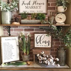 Happy Friday! If you watched my Insta stories yesterday you got a sneak peek of the spring sign collection that Emily @qbhome and I collaborated on. I couldn't wait to give my breakfast nook a spring makeover with these beauties! We hope you love them! Head over to @qbhome to snag some for yourself  • • • #farmhousefriday #farmhousefridays #foliagefridayfreshorfaux #farmhousehappy #springdecor #woodsigns #flowermarket #modernfarmhouse #spring #garden #brickwall #woodshelves #design…
