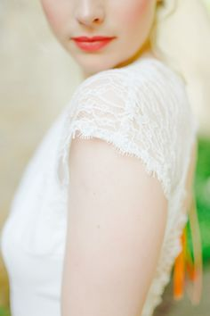 Lace cap sleeve wedding dress | Claire Graham Photography | see more on: http://burnettsboards.com/2015/04/coral-peach-wedding-editorial/