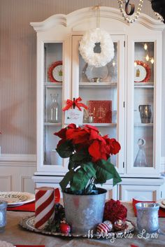 Fill a dining room hutch with red and white china and festive holiday themed plates from @HomeGoods for an easy seasonal update. A few new red accessories will change the entire look of a room, display space {even if it's inside a cabinet} is a perfect spot to add some holiday cheer! #sponsoredpin