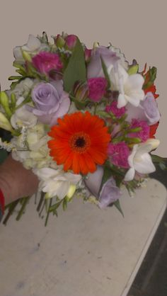 The Gerbera Daisy really stands out in this bride's bouquet. Do you have a favorite flower? We always do our best to deliver exactly what you have in mind! americasflorist.com