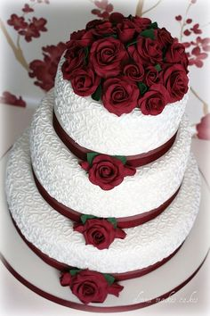 Ivory and Burgundy Roses Wedding Cake, 4 tier, black and burgundy, red, swirls. www.signature-event.com
