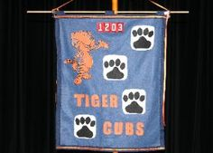 Den Flag http://cubscoutpack1203.com/oldsite/Tigers_files/Tiger_Flag-300x215.jpg