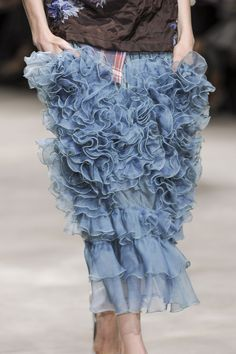 Dries van Noten. waaaaaaay too many ruffles and an anorexic model. this is what is wrong with modern fashion. extreme and skeletal.