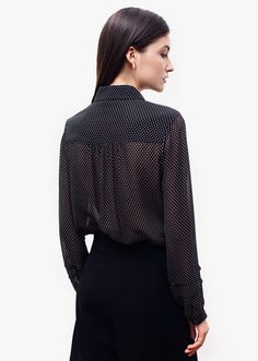 Lauren black shirt . Classic shirt tailoring is balanced by feminine details. Gentle folds at front and back, delicate pleats on the sleeves, playful transparency and fun polka-dots. The loose silhouette brings fluidity and softness, while ensuring a comfortable fit. Fall Capsule, Polka Dots, Bring It On, Delicate, Feminine, Turtle Neck, Silhouette, Classic, Fit