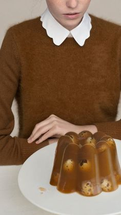 Her sweater matches the terrine.  (I do NOT want to know what's floating in that thing)