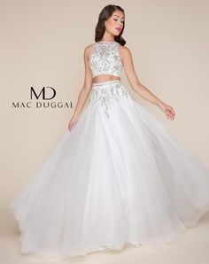 Two piece, floor length ball gown with beaded sheer illusion top and dropped waist, pleated lace tulle skirt with exaggerated sweep train. This dress is available in White and Powder blue.