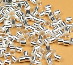 2mm SilverPlated Jewelry Beading CRIMP TUBES 100 pcs. offered by HalfPennyBoutique, $3.49 https://www.etsy.com/listing/155973684/2mm-silver-plated-jewelry-beading-crimp