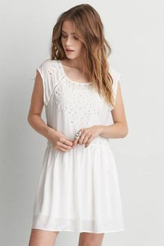 AEO White Eyelet Dress  by AEO | Bring on the warm. This dress is lightweight and flowy, and it features serious attention to the details with eyelet cutouts.  Shop the AEO White Eyelet Dress  and check out more at AE.com.