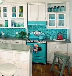 turquoise kitchen...love that stove!
