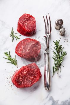 Raw fresh marbled meat Steak and and meat fork on white marble background - The Picture Pantry Food Stock Photo Library Raw Photography, Food Photography Styling, Food Styling, Marbled Meat, Scrambled Eggs With Cheese, Meat Steak, Fresh Meat, Mets, Steaks