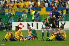 El Hadji Diouf of Senagal consoles Anders Svensson of Sweden after the Sweden v Senagal, World Cup Second Round match played at the Oita Big Eye Stadium, Oita, Japan on June 16, 2002. Senegal won 2-1 after extra time.