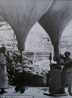 Women working in a Lancashire asbestos factory in 1918...They were guaranteed a daily meal with meat...a rarity...