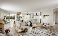 The open plan family, dining and kitchen zone is bathed in natural light