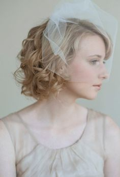 http://www.haircareandstyles.com/wp-content/uploads/2012/06/beautiful-bride-with-short-wedding-hairstyle.jpg