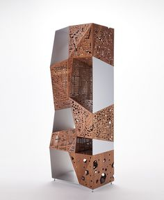 Design: Steven Holl, 2006 / After the first edition in walnut, since 2011, Riddled Totem is offered in ebony: the valuable dark wood confers further charm and elegance to the sculptural volumes, already characterized by the typical perforated texture of many famous works by Steven Holl. It consists of an aluminium frame and five elements made of 2-mm wooden sheets folded in an origami-like fashion, thanks to a complex and patented technological process.