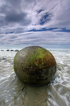 Stills Photo Tours - David Still -  New Zealand - Incoming tide swirling around the base of a mysterious Moeraki Boulder.    I'm anxious to do some research and studying about these.