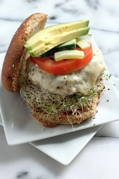 Looks so good --> California Turkey Burger // alfalfa sprouts, pepper jack cheese, tomato, cucumber slaw, avocado, and a light drizzle of Russian dressing