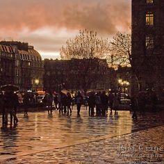 Parvis de Notre Dame at Sunset ~ Rita Crane Photography:  France / Paris / people / rain / reflection / umbrellas / street / building / photography / silhouette / notre dame / sunset  colors by Rita Crane Photography, via Flickr