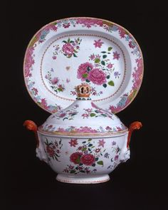 FAMILLE ROSE TUREEN, COVER & STAND A famille rose deep oval tureen, cover and stand painted with sprays of flowers, with plumed lady handles and a coronal knop after Meissen forms. Qianlong period, circa 1760