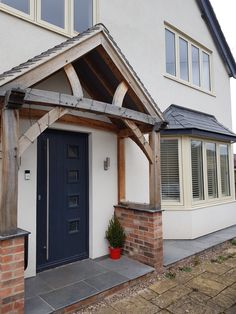 in Clotted Cream Windows teamed with a Milano Anthracite Grey Solidor Modern Exterior, Exterior Design, Anthracite Grey Windows, Rendered Houses, Grey Front Doors, Recycled Brick, Contemporary Doors, Grey Houses, Bay Windows