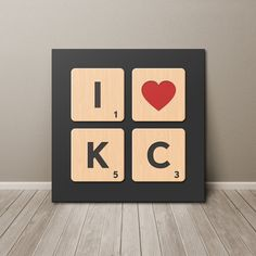 Show your love for Kansas City!  Graphic style wooden Scrabble tiles with letters and values printed on canvas. • Printed on acid free canvas • Gallery wrapped around a 1.375 thick untreated wooden frame • Hardware for hanging not included • 3 to 5 business days production + shipping