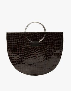 From Veda, a handbag in Croc. Main compartment. Two exterior pockets. Leather tab detailing. Silver-toned circular metal rings. Fully lined.  • 100% genuine leather body • 100% polyester lining • Professional leather clean only • Made in USA