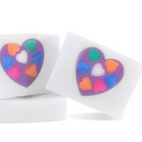 Melt and Pour Soap Recipe: Conversation Hearts Soap. This soap looks like sweethearts candies embedded into a large heart. We love the scent of this soap: citrus with orchid, jasmine, rose, amber and musk.