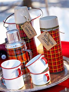 Plaid Thermos bottles - Red. I have one of these - generally in my kitchen with some silk sunflowers in it for a pop of cheery color.