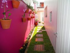 Paint the wall in a narrow area  with  a bright colour.