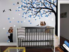 Modern nursery wall decal with creative tree, leaves, blossoms,raccoons and birds. This graceful baby room decal is also available in other colors and