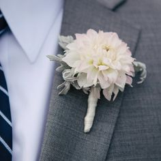 The groomsmen wore simple boutonnieres of large, white dahlias with gray suits.