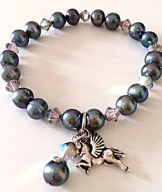 Fresh water cultured peacock coloured pearl charm bracelet on Etsy, £14.00