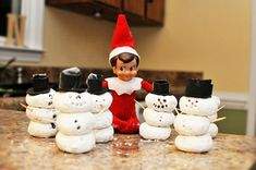 Army of Snowmen made of powdered donuts.... I know he's gone home now but I'll pin this for his next visit :)