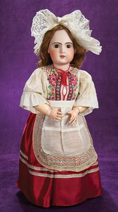 Marks: 1907 14. Comments: Jumeau/SFBJ,circa 1907. Value Points: pretty bebe with lovely bisque,original body and body finish,wearing beautiful multi-layered folklore costume including very fine lace coiffe.