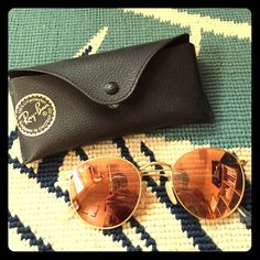 78577a55a44 Ray-Ban Round Metal Mirrored Colored Sunglasses Women s round metal frames  with rose orange lenses. Comes with original case