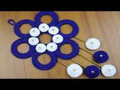 Woolen Craft Idea - How to make door hanging - Best reuse ideas - Best out of waste - DIY Craft ideas Hello Friends Today in this video, I would like to shar. Twine Crafts, Bead Crafts, Diy Arts And Crafts, Diy Crafts, Door Hanging Decorations, Woolen Flower, Wall Hanging Designs, Woolen Craft, Diy Plastic Bottle