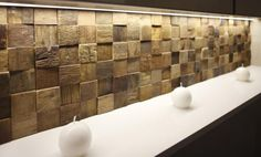 Square timber tiles, different heights create great shadows for a feature wall, splashback or island bench panel