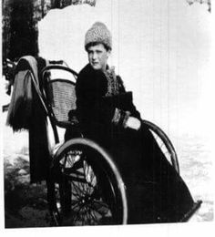 "Tsarevich Alexei Nikolaevich Romanov of in a wheelchair at the Alexander Palace Park in 1913. ""AL"""