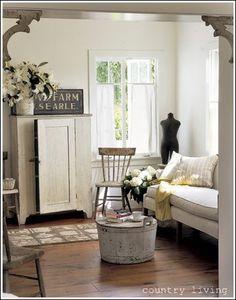 Love these brackets in the doorways - instead of having arches added -- hmmm