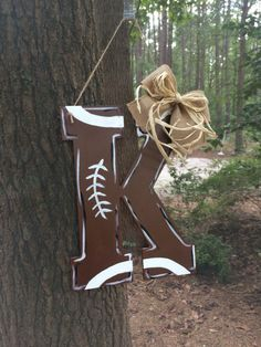 A personal favorite from my Etsy shop https://www.etsy.com/listing/457985468/football-monogram-door-hanger-letter