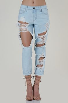 Casual mid rise straight leg jeans with heavy distressing throughout the front. 5 pocket design with button and zip closure.