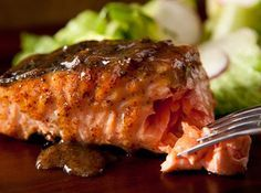 Maple-Mustard Grilled Salmon Recipe.  Olive oil and 100%maple syrup.  Baked.