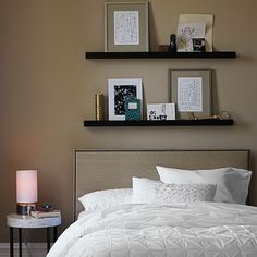 Love this idea for over the bed.  Maybe with metal shelves? Deep Picture Ledge | west elm