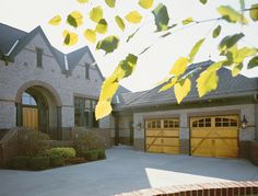 @Clopay Doors | Residential Garage Doors and Entry Doors | Commercial Doors Reserve Collection Semi-Custom Handcrafted Wood Carriage House Garage Doors