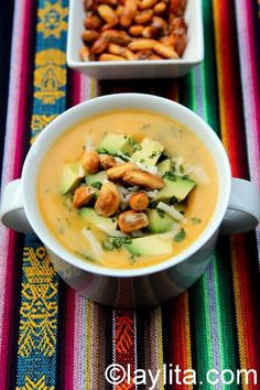 Potato soup with cheese, cilantro, avocado and tostado corn