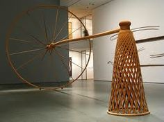 Martin Puryear redefines the space by the implications of motion in a space.  The tool/non-tool relationship requires the imagination of the audience to complete the body/ space / venue relationship